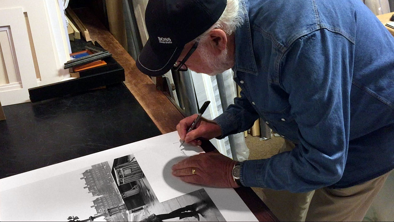 arthur steel signing a black and white photographic print