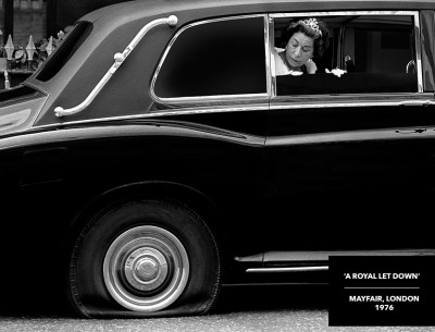 queen lookalike flat tyre black and white photograph
