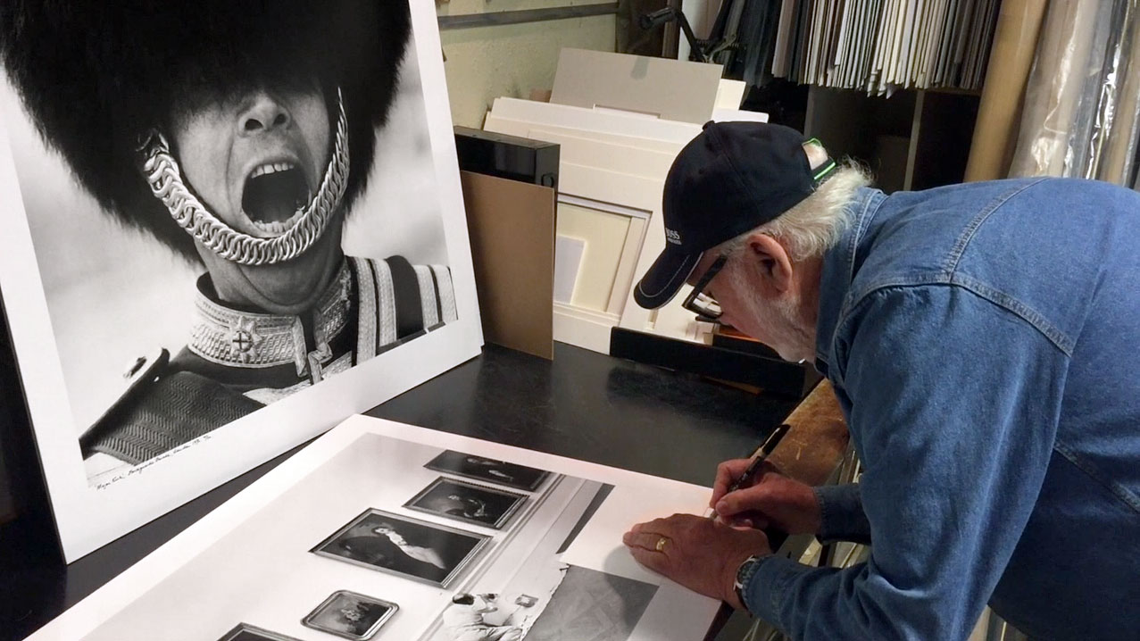 photographer arthur steel signing a photograph
